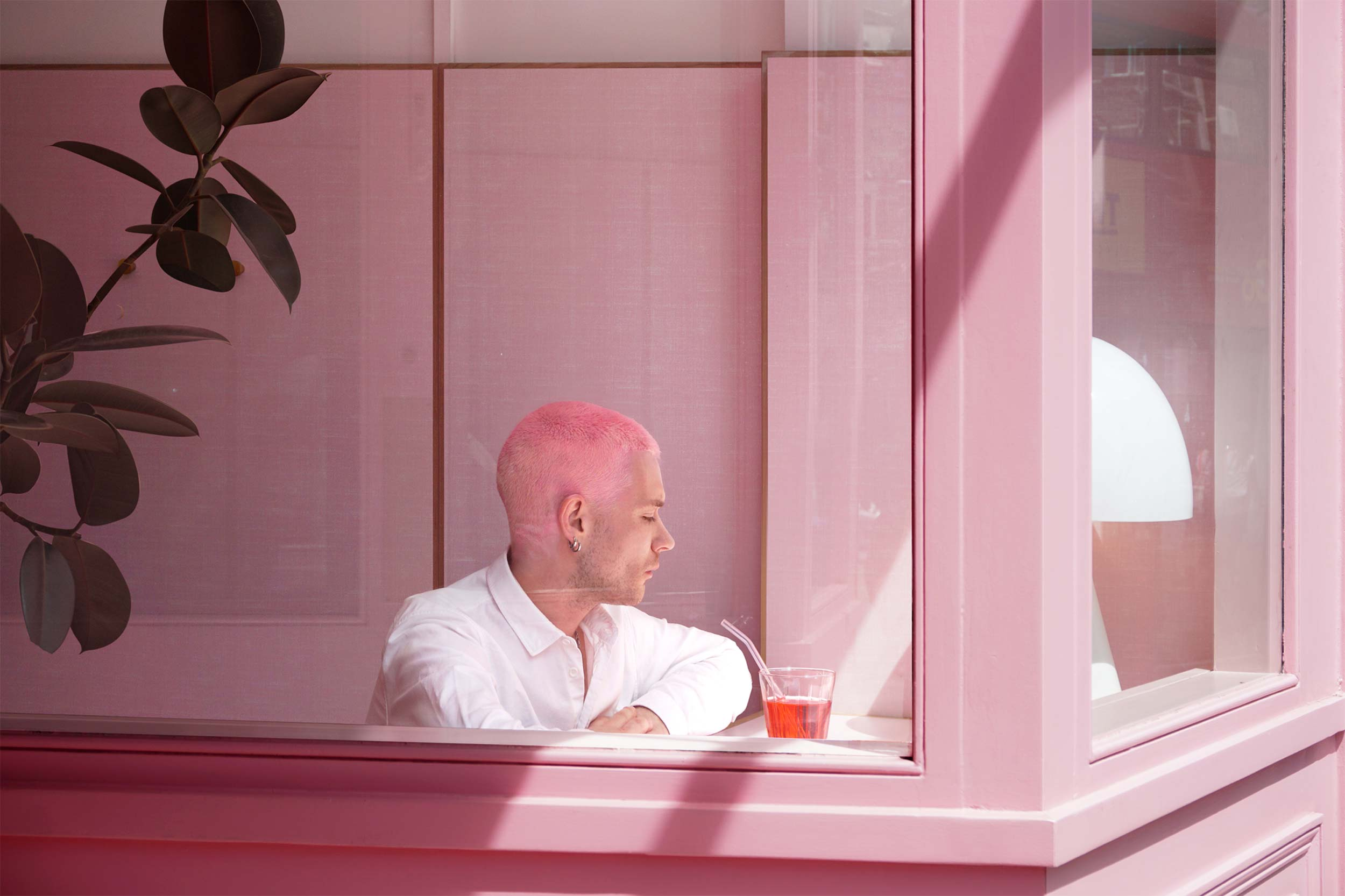 A pink Formica cafe by Child Studio
